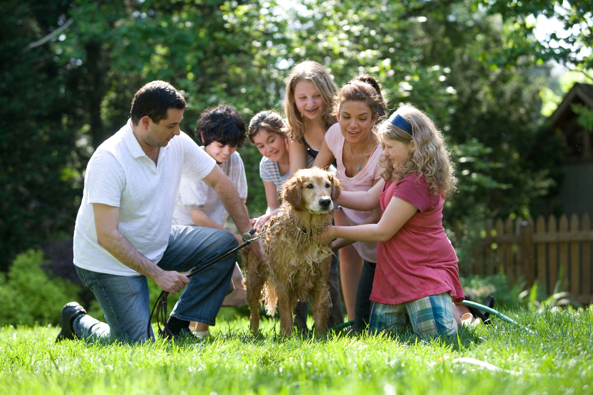 family-in-yard-with-dog